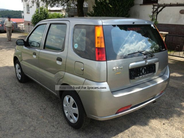 2004 subaru justy all wheel drive good condition car photo and specs. Black Bedroom Furniture Sets. Home Design Ideas